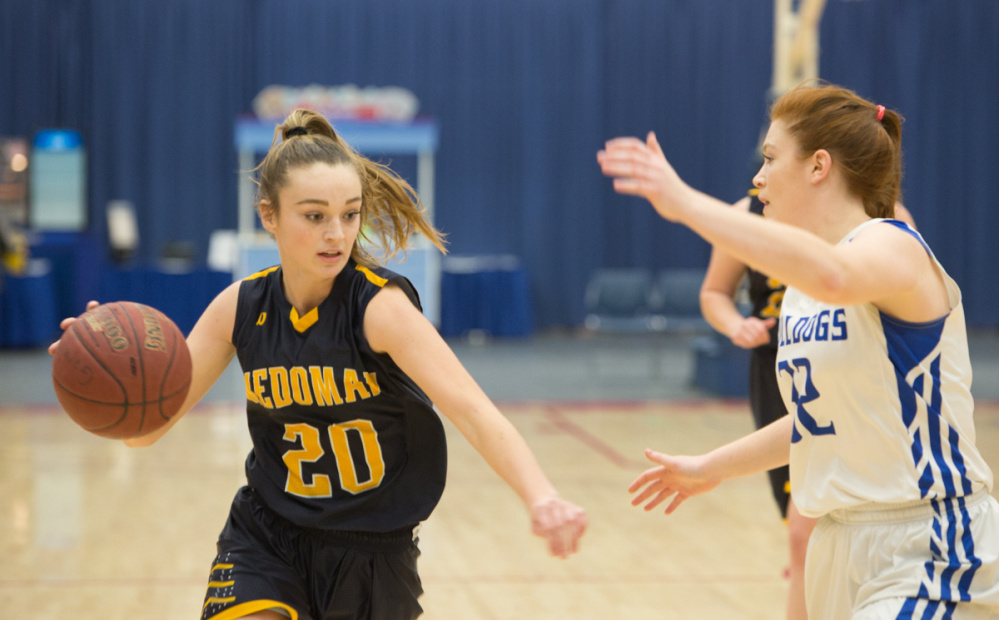 Medomak's Sadie Cohen (20) looks to drive to the basket past Madison's Lauren Hay, right, at the Gold Rush Invitational Tournament on Wednesday at the Augusta Civic Center.