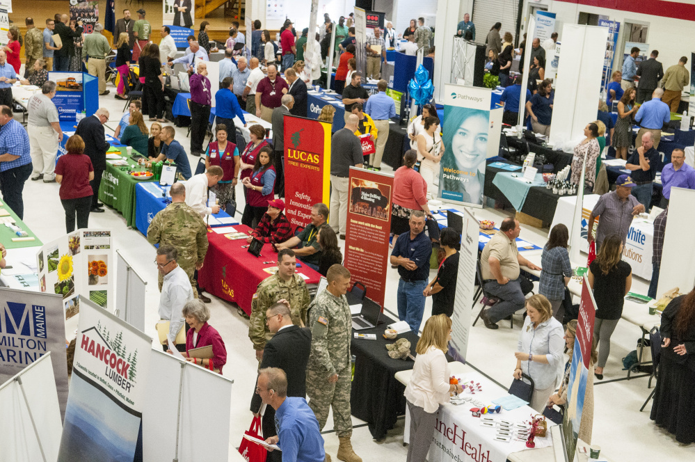 The floor is crowded with 143 employers and 10 veterans organizations during a job fair Aug. 29 at the Augusta State Armory. A new unemployment claims system the state introduced on Dec. 6 has baffled claimants and left them without benefits while they pursue jobs.