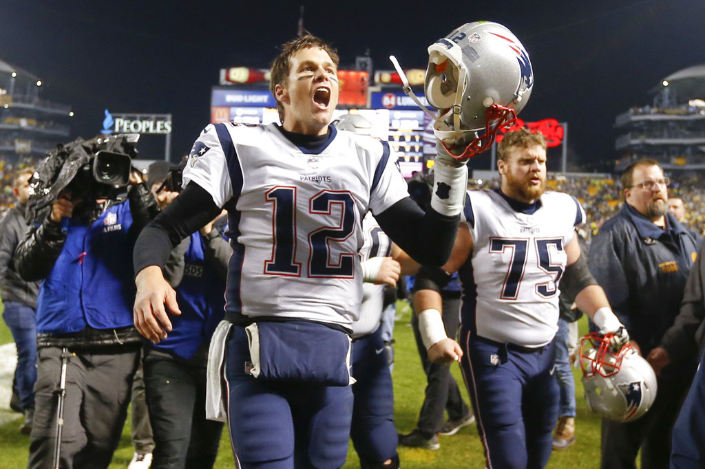 Tom Brady celebrates the Patriots' stunning victory over the Steelers as the team leaves the field in Pittsburgh Sunday. The Patriots won 27-24.