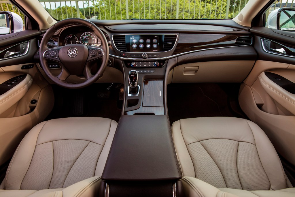 The 2018 Buick LaCrosse has ample knee and legroom, and when there is no third person riding in the back, a pull-down center armrest is available with dual cupholders.