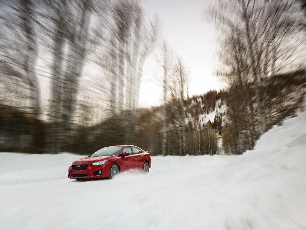 The 2018 Subaru Impreza Sport Sedan. The Impreza's steering is responsive. The suspension manages bumps and keeps the car stable in quick maneuvers.
