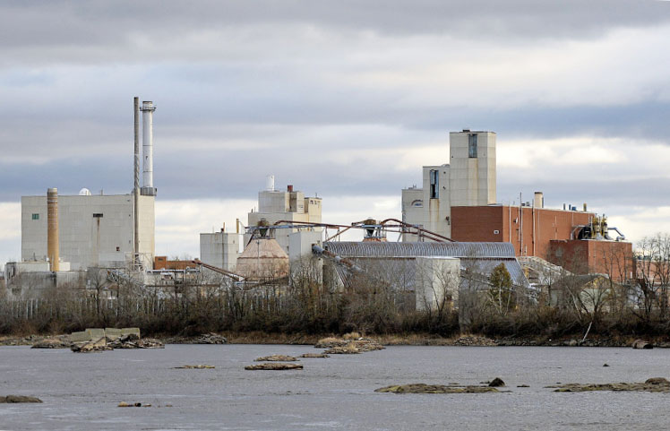 """Of 16 companies applying to help the University of Maine use the former Old Town paper mill site, above, for generating wood-fired steam and electricity, New York-based ConEdison Solutions won an """"award to negotiate."""" It was chosen partly because it would use the mill's biomass boiler."""