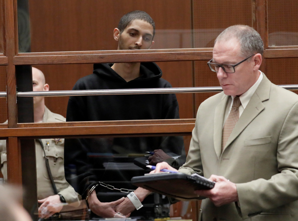 """Tyler Barriss, 25, appears in court for his extradition hearing with his lawyer Mearl Lottman in Los Angeles after being arrested in a """"swatting"""" incident in which police shot and killed a man in Wichita, Kan."""