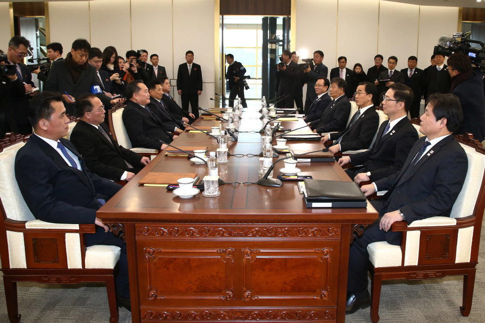 South Korean Unification Minister Cho Myoung-gyon, third from right, and head of North Korean delegation Ri Son Gwon, third from left, and their delegations meet at the Panmunjom in the Demilitarized Zone in Paju, South Korea, on Tuesday. Senior officials said they would try to achieve a breakthrough in their long-strained ties as they sat for rare talks at the border to discuss how to cooperate in next month's Winter Olympics in the South and other issues.
