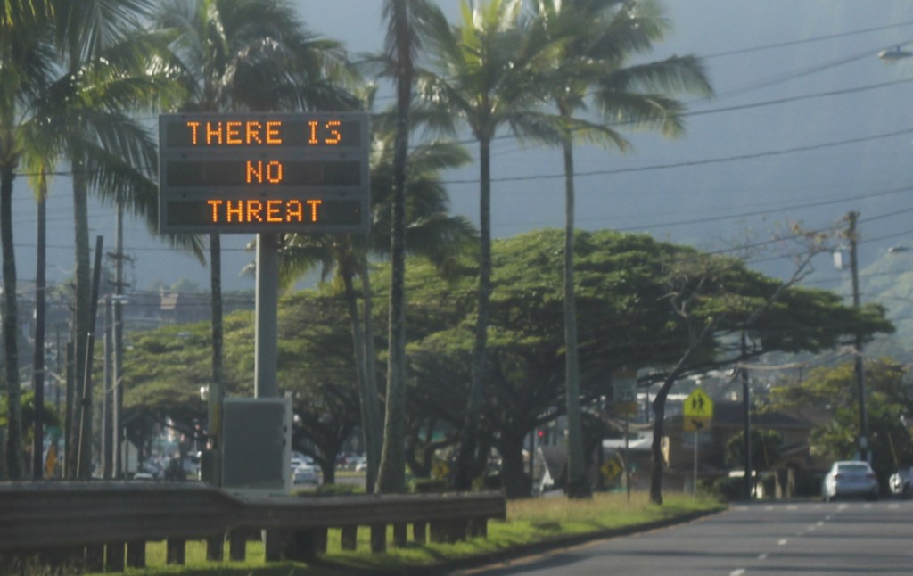 """A highway median sign broadcasts a message of """"There is no threat"""" in Kaneohe, Hawaii, on Saturday after an emergency alert warning of an imminent missile strike mistakenly went out. (Jhune Liwanag via The AP)"""