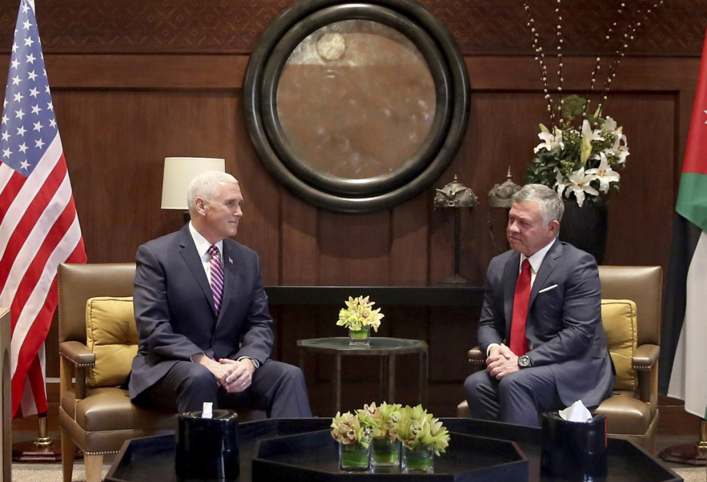 U.S. Vice President Mike Pence, left, meets with King Abdullah II at the Husseiniya Palace in Amman, Jordan, on Sunday.