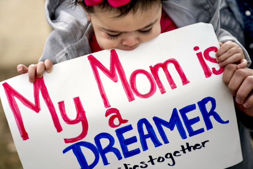 Yesenia Aguilar of Reading, Pennsylvania, holds her 1-year-old daughter, Denalli Urdaneta, at an immigration rally on Capitol Hill in Washington on Tuesday.
