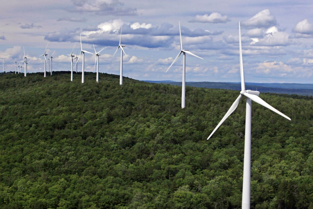 """Wind turbines line a ridge in Township 8, Range 3 in Maine. Critics of the governor's newly imposed wind-power moratorium said it """"would be unable to withstand legal scrutiny,"""" while others called it """"great news for the thousands ... who are opposed to wind development"""" as a threat to tourism."""