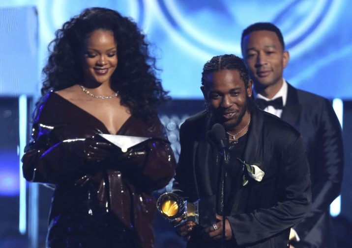 """Rihanna, left, and Kendrick Lamar accept the award for best rap/sung performance for """"Loyalty,"""" from John Legend at the 60th annual Grammy Awards at Madison Square Garden on Sunday in New York."""