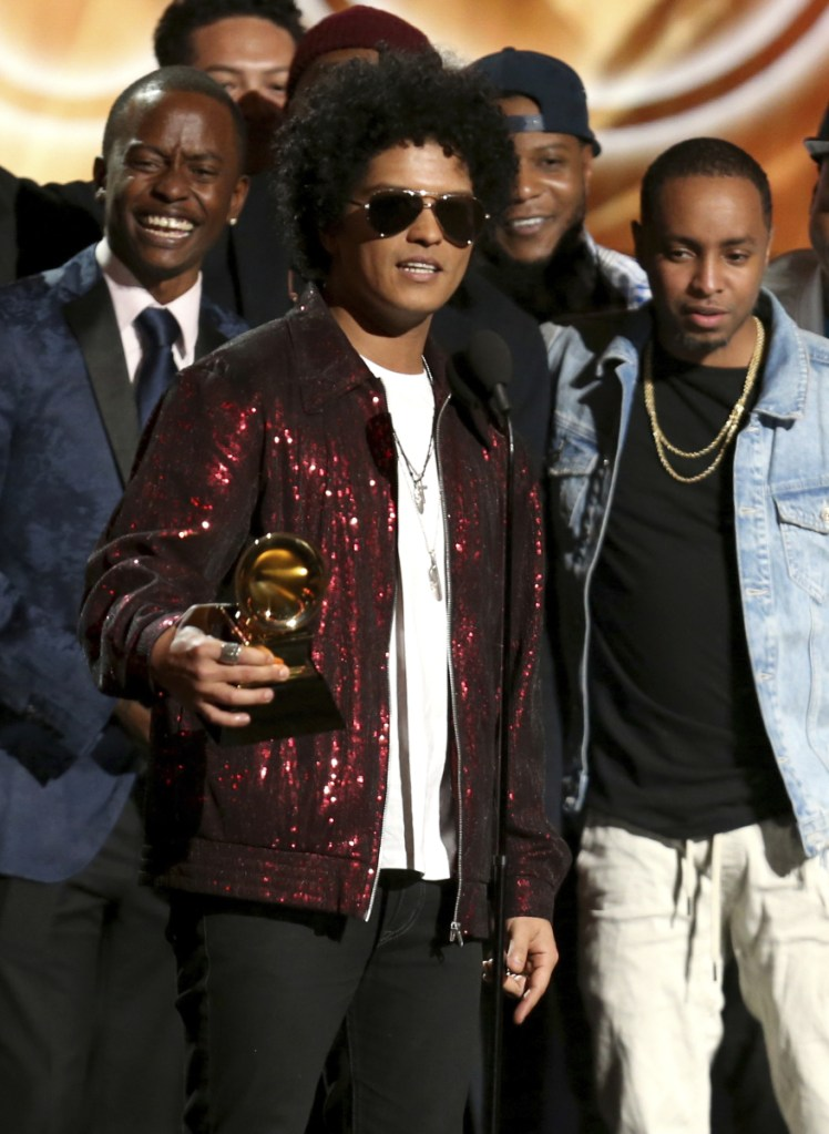 """Bruno Mars accepts the award for album of the year for """"24K Magic"""" at the 60th annual Grammy Awards at Madison Square Garden on Sunday in New York."""