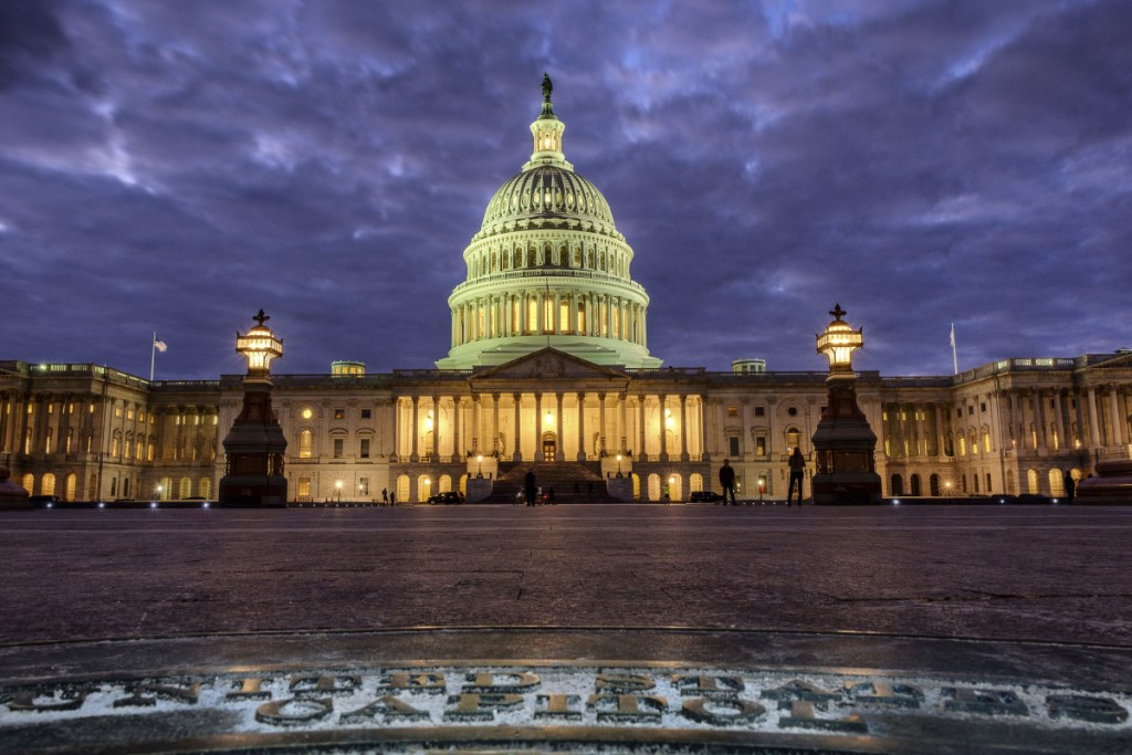 The U.S. Capitol Building is lit up as night falls in Washington.