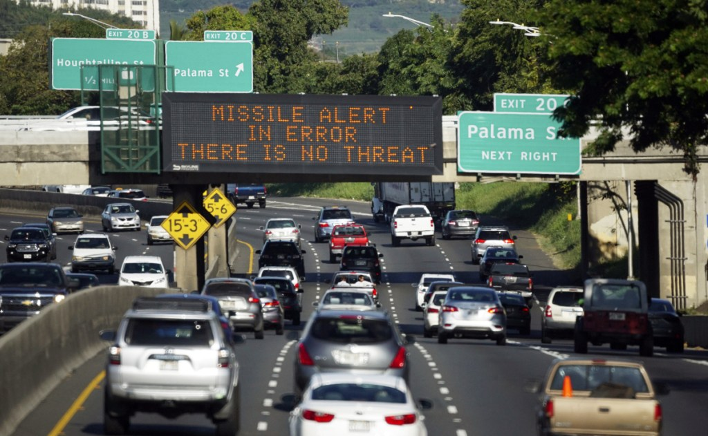 """Cars drive past a highway sign that says """"MISSILE ALERT ERROR THERE IS NO THREAT"""" on the H-1 Freeway in Honolulu, Hawaii, on Jan. 13. A Hawaii employee mistakenly sent an alert warning of an incoming ballistic missile."""