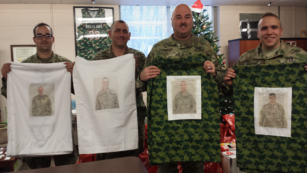 Maine National Guard members holding some of the pillowcases from left are Spc. Sean Farrell, Sgt. Ryan Gauthier, CW3 Jon Hunt and Staff Sgt. Josh Sennett.