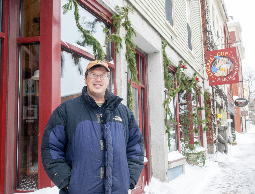 """Restaurateur Geoff Houghton sits in his first brew pub, The Liberal Cup in Hallowell, on Friday. Houghton says he's concerned the upcoming Water Street construction project will result in significant sales losses that could hamper his """"being able to keep my staff intact."""""""