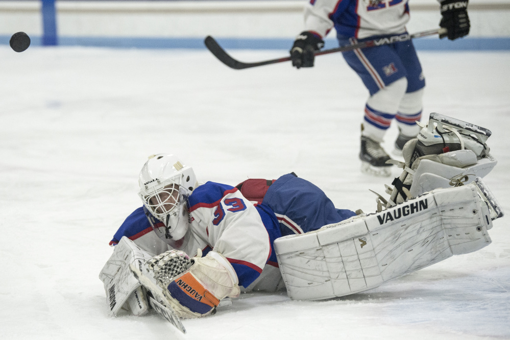 Messalonskee goalie Eli Michaud makes a save during a game agaimst Lawrence/Skowhegan/MCI last Wednesday night at Colby College.