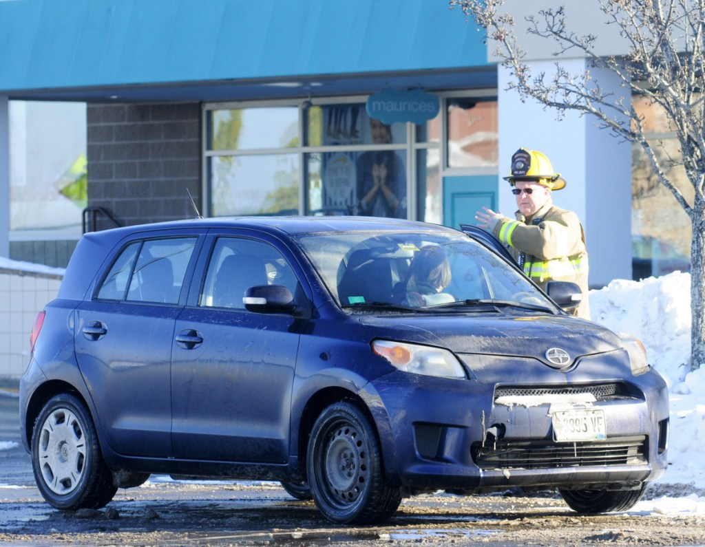 The Augusta Fire Department evacuated stores and parking lots while fighting a propane tank fire Tuesday morning near American Eagle Outfitters store.