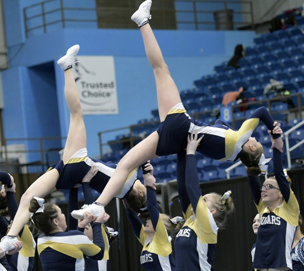 Mt. Blue cheerleaders compete during the Kennebec Valley Athletic Conference championships Monday in Augusta.