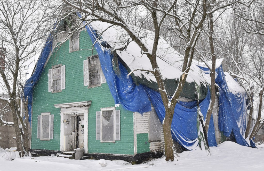 Charles McIntyre's house on Main Street in Clinton, seen Wednesday, has been in what the town calls a state of disrepair for decades and will be the subject of a meeting by the town to determine a course of action.