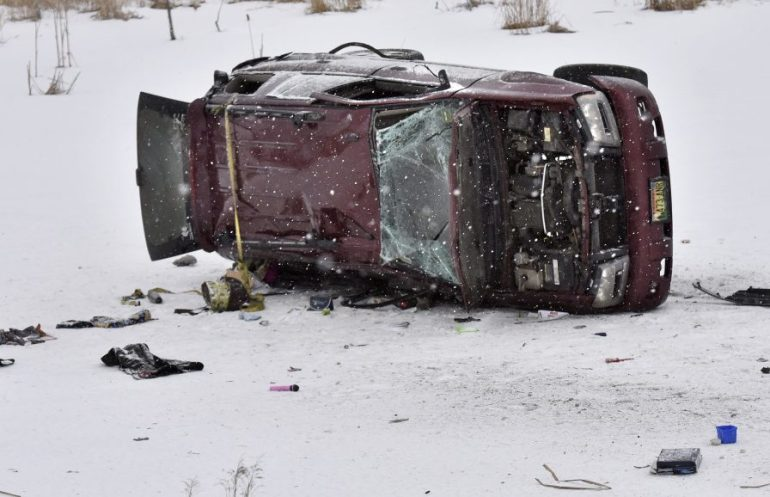 A burned, overturned truck lies on the ice of a small pond along Route 2 in Skowhegan early Monday. A pregnant woman died in the accident and the baby was reportedly delivered by C-section after the accident.