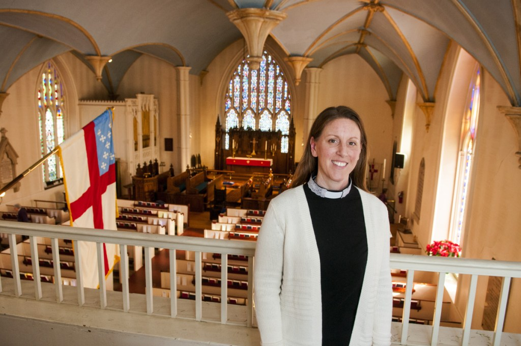The Rev. Kerry Mansir poses inside Christ Church Episcopal in Gardiner. She had been a deacon and was ordained as a priest Jan. 20.