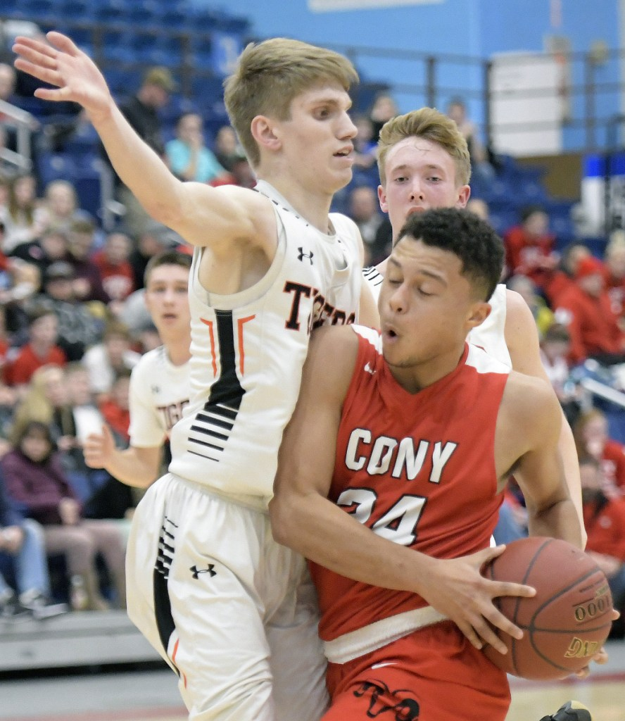 Cony senior Jordan Roddy tries to get past Gardiner's Cole Lawrence during a Kennebec Valley Athletic Conference Class A game Monday night at the Augusta Civic Center.