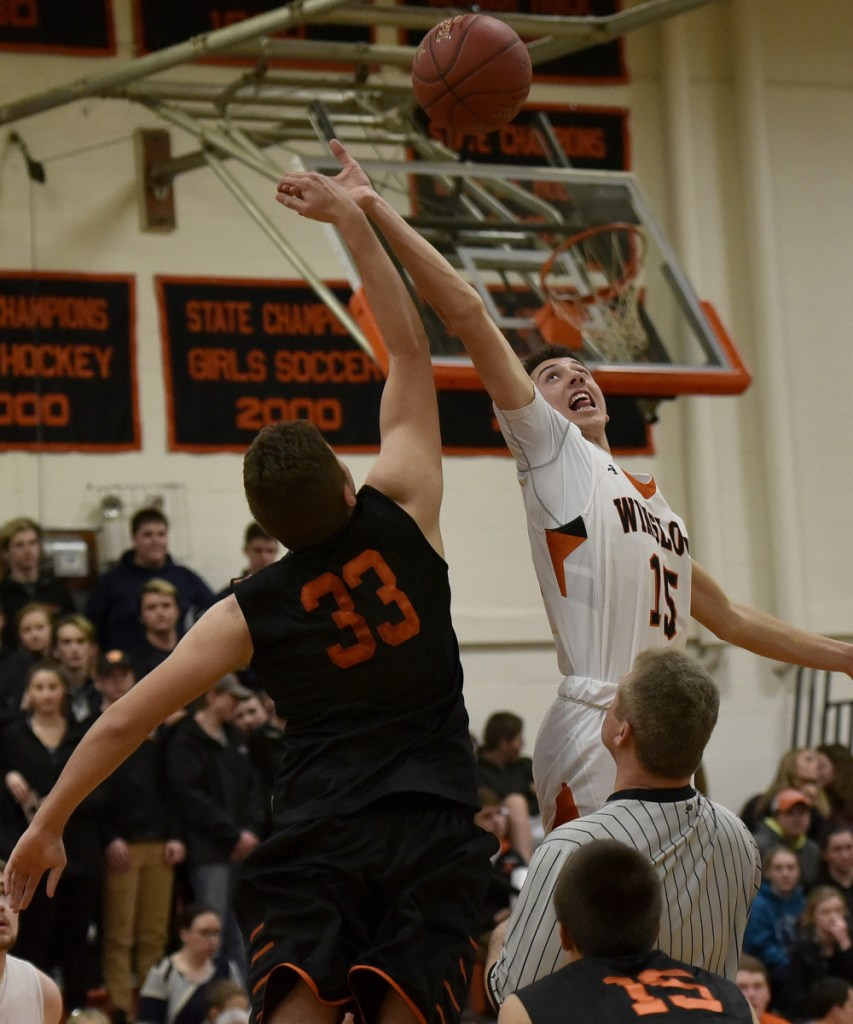 Skowhegan's Kiel LaChappelle and Winslow's Jack Morneault go up for jump ball during a game Tuesday in Winslow.