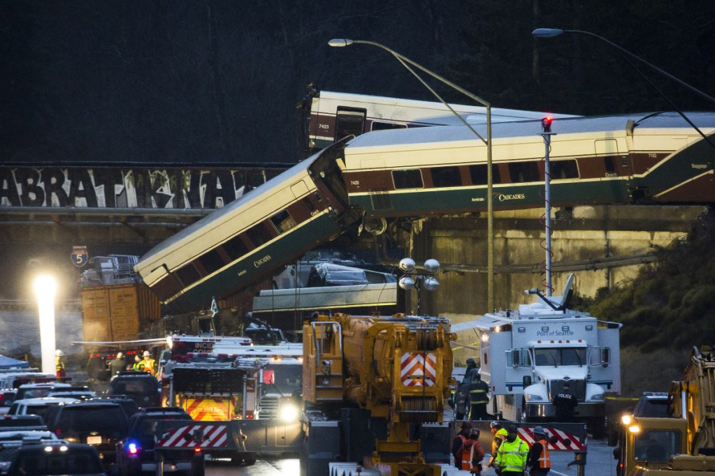 Amtrak train cars lie on Interstate 5 after a derailment in DuPont, Washington, on Dec. 18, 2017. The crash occurred when an engineer failed to slow down for a curve, killing three people. Positive Train Control would have sensed where the train was and automatically slowed before it reached the curve.