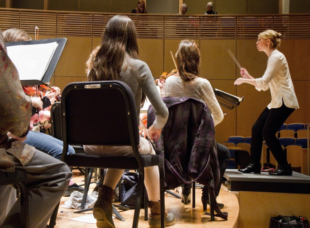 Director Emily Isaacson leads the Oratorio Chorale and the Bowdoin College Chorus during a rehearsal at the college's Studzinski Recital Hall in 2014. She will be artistic director for one of two Bach festivals in Portland in June. Staff file photo by Carl D. Walsh
