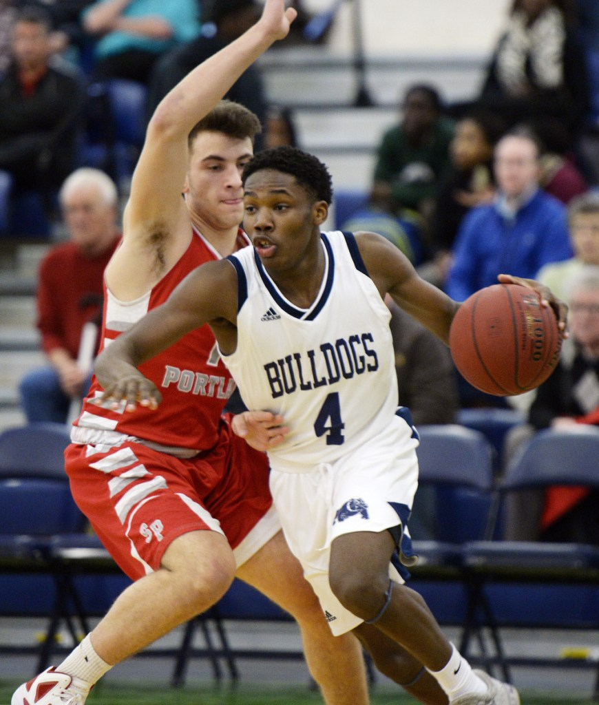 Portland's Terion Moss drives to the basket as South Portland's Noah Malone plays defense in a game on Jan. 11. (Staff photo by Shawn Patrick Ouellette/Staff Photographer)