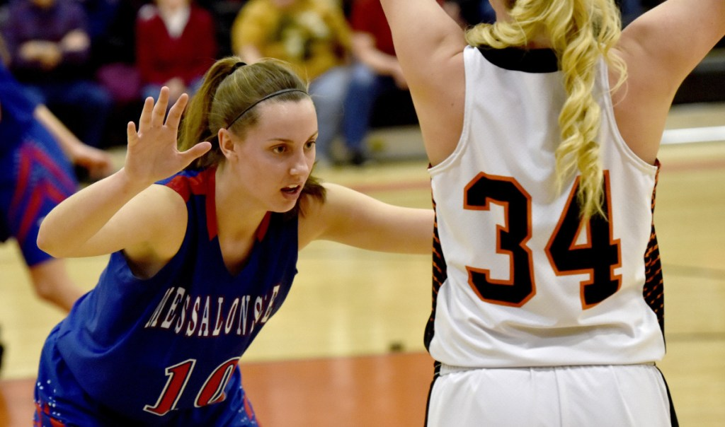 Skowhegan's Mariah Dunbar looks to make a pass as Messalonskee's Katie Seekins defends during a Kennebec Valley Athletic Conference Class A game Monday night in Skowhegan.