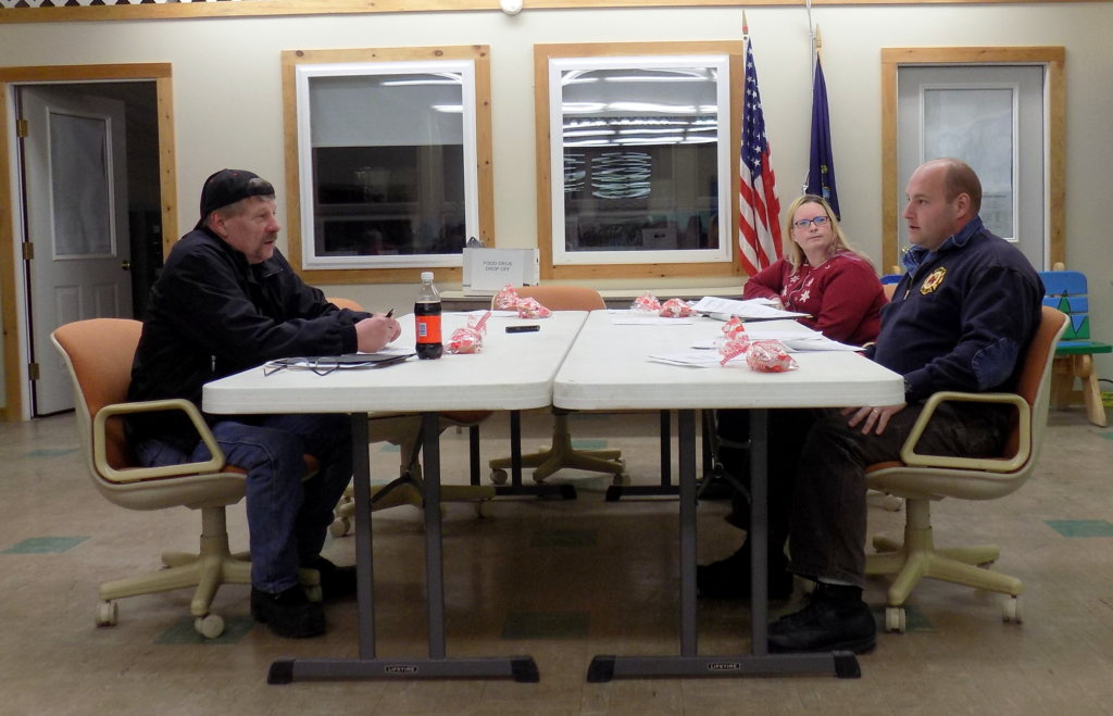 Selectmen Matt Welch, left, Tiffany Estabrook and Edward Hastings IV discuss town warrant articles on liquor sales and a land use ordinance during Thursday night's public hearing in Chesterville.