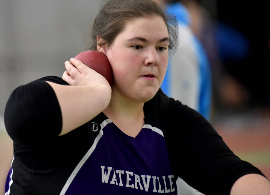 Waterville junior Sarah Cox, center, prepares to throw the shot put at a Feb. 3 Kennebec Valley Athletic Conference track and field meet at Bowdoin College in Brunswick.