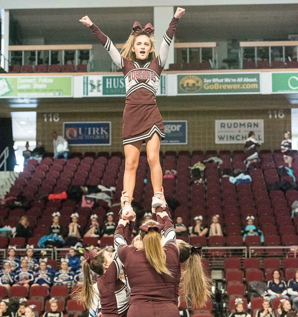 The Monmouth Mustangs compete in the Class C state cheerleading championships Saturday in Bangor.