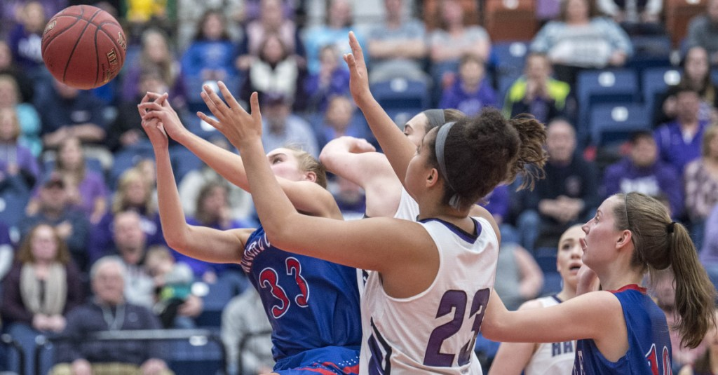 Messalonskee senior Ally Turner battles for a rebound with Hampden's Bailey Donovan during the Class A North title game Friday night at the Augusta Civic Center.