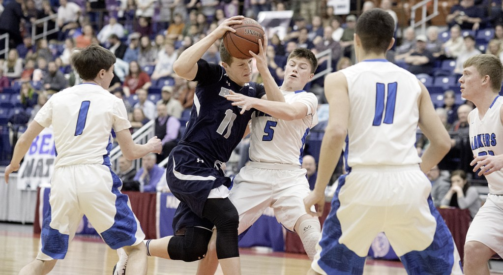 Ernie Lorange of Gould drives through traffic during the Class D South final against top seed Greenville at the Augusta Civic Center on Saturday afternoon.