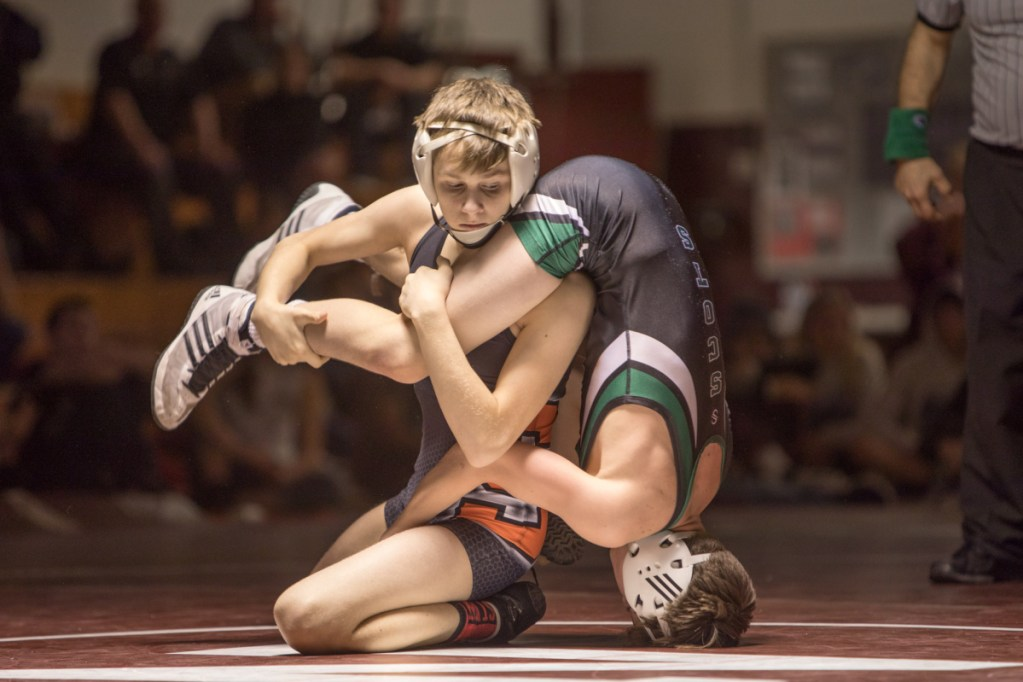 Skowhegan's Jake Craig gets a hold of Bonny Eagle's Colby Frost during the finals of the 106-pound division at the New England qualifier Saturday at Nokomis Regional High School in Newport.