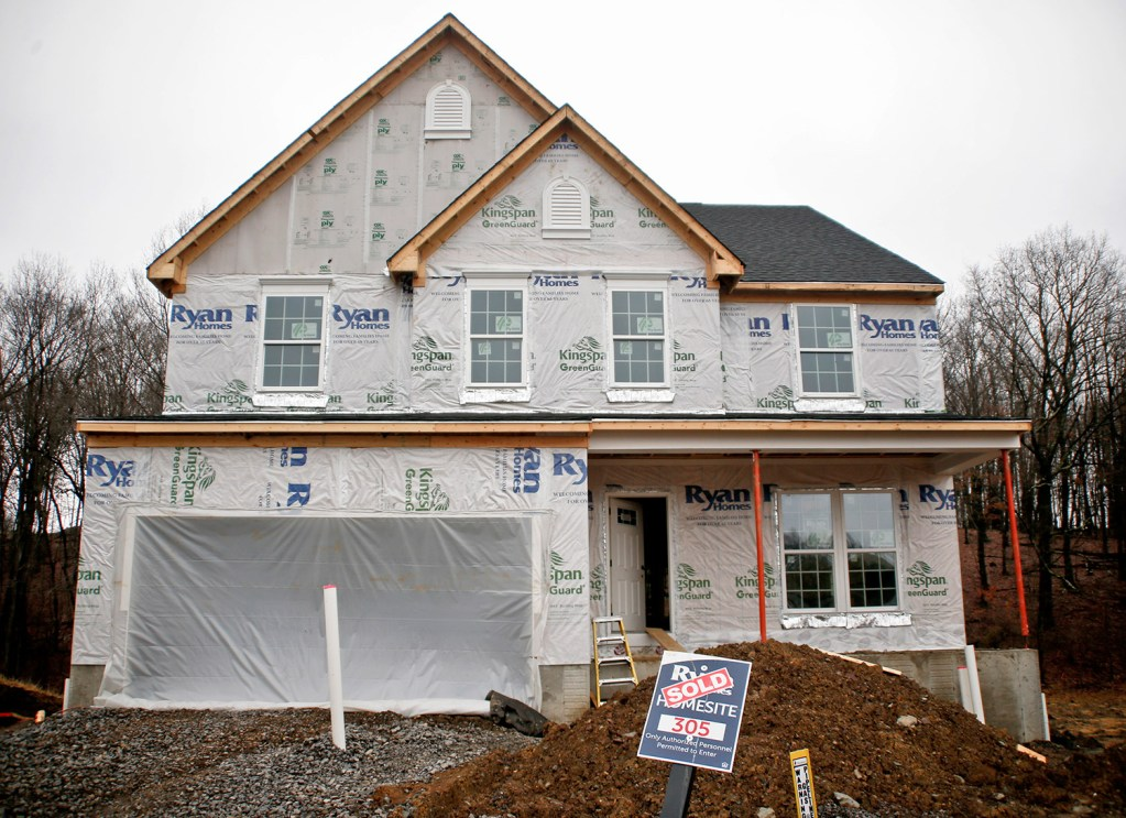 Construction is under way at a new housing project in Zelienople, Pa., this month.  Sales of new U.S. homes fell in January for the second straight month.