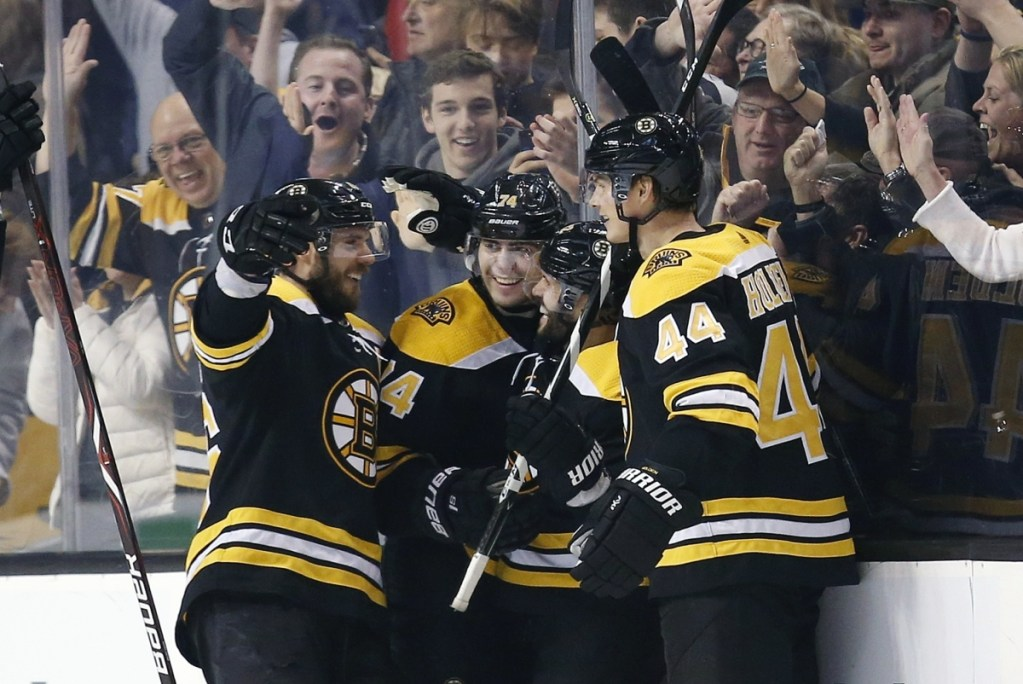Brian Gionta, second from right, celebrates his goal with teammates, from left, David Krejci, Jake DeBrusk, and Nick Holden during the third period of the Bruins' 7-4 win over the Chicago Blackhawks on Saturday in Boston.