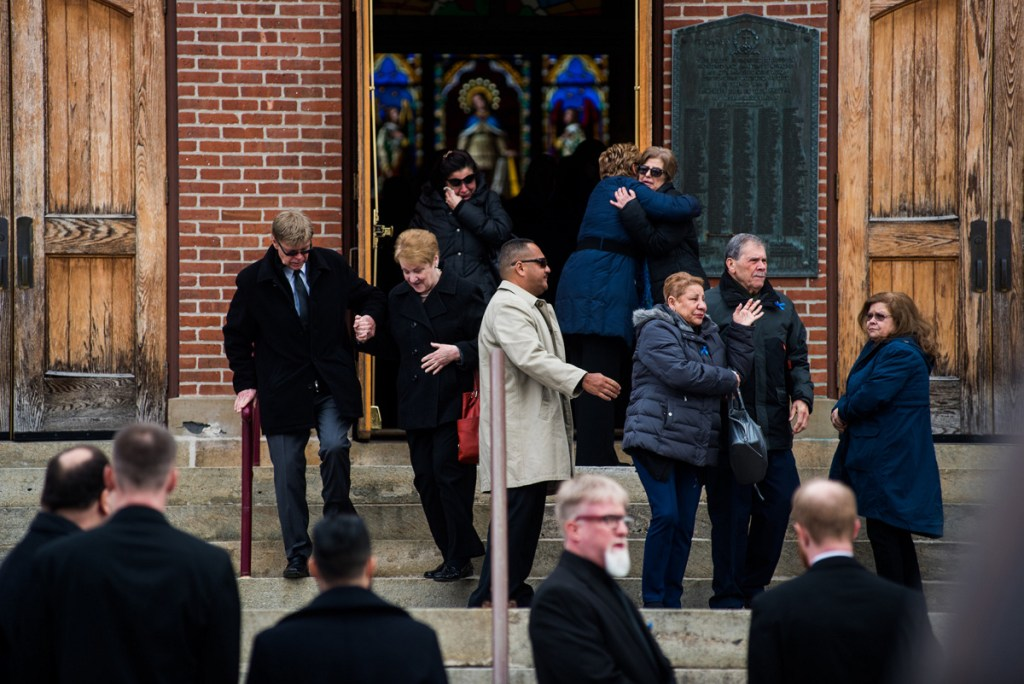 Family and friends grieve outside St. Mary's Church after the funeral service for Marissa Kennedy in the City of Newburgh, N.Y., on Saturday. Marissa Kennedy, formerly of New Windsor was beaten allegedly to death by her mother and stepfather in Stockton Springs, Maine. Times Herald-Record/Kelly Marsh
