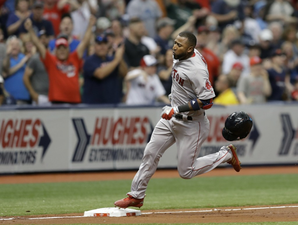 Eduardo Nunez of the Boston Red Sox loses his helmet as he races around third base for a two-run, inside-the-park home run off Tampa Bay pitcher Chris Archer in the second inning of Thursday's game at St. Petersburg, Fla. Boston opened a 4-0 lead on the Rays, but the bullpen blew the lead and the Red Sox lost, 6-4.