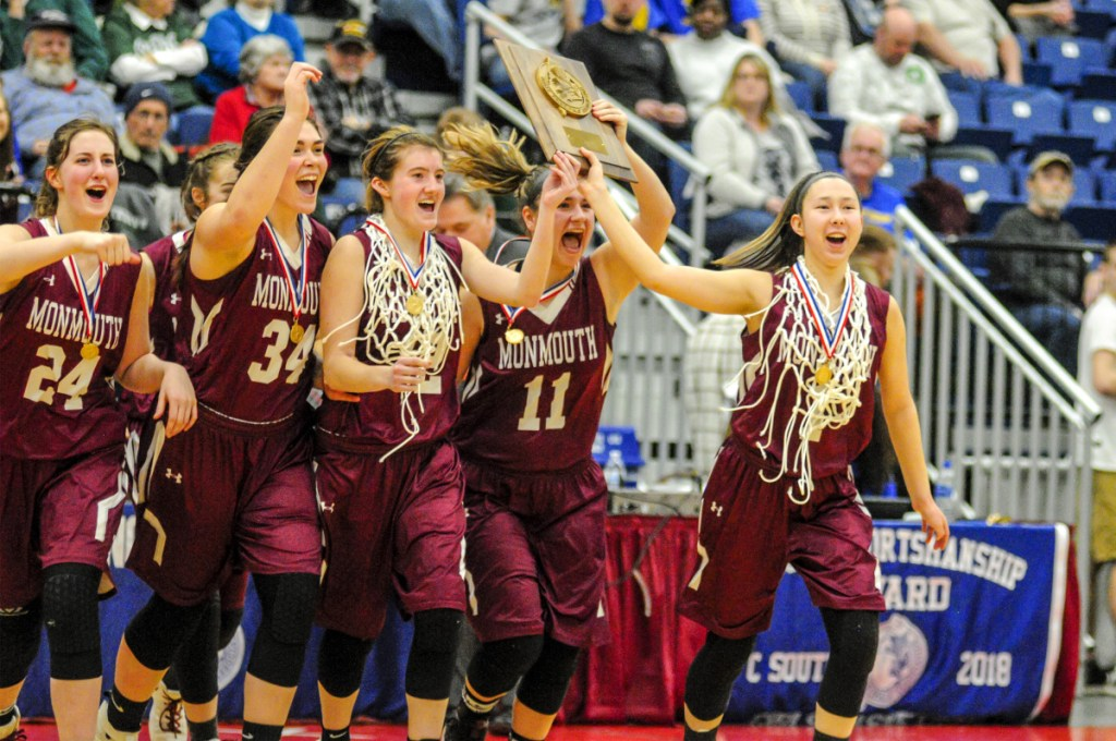 The Monmouth Academy girls basketball team reacts after defeating Boothbay in the Class C South final last week at the Augusta Civic Center. The Mustangs face Houlton in the state championship game this weekend.