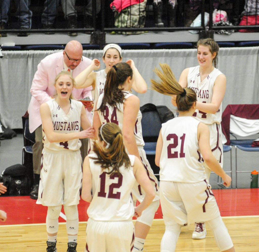 Staff photo by Joe Phelan The Monmouth Academy bench celebrates after the Mustangs took off to an early lead against Houlton in the Class C state championship game Saturday at the Augusta Civic Center.