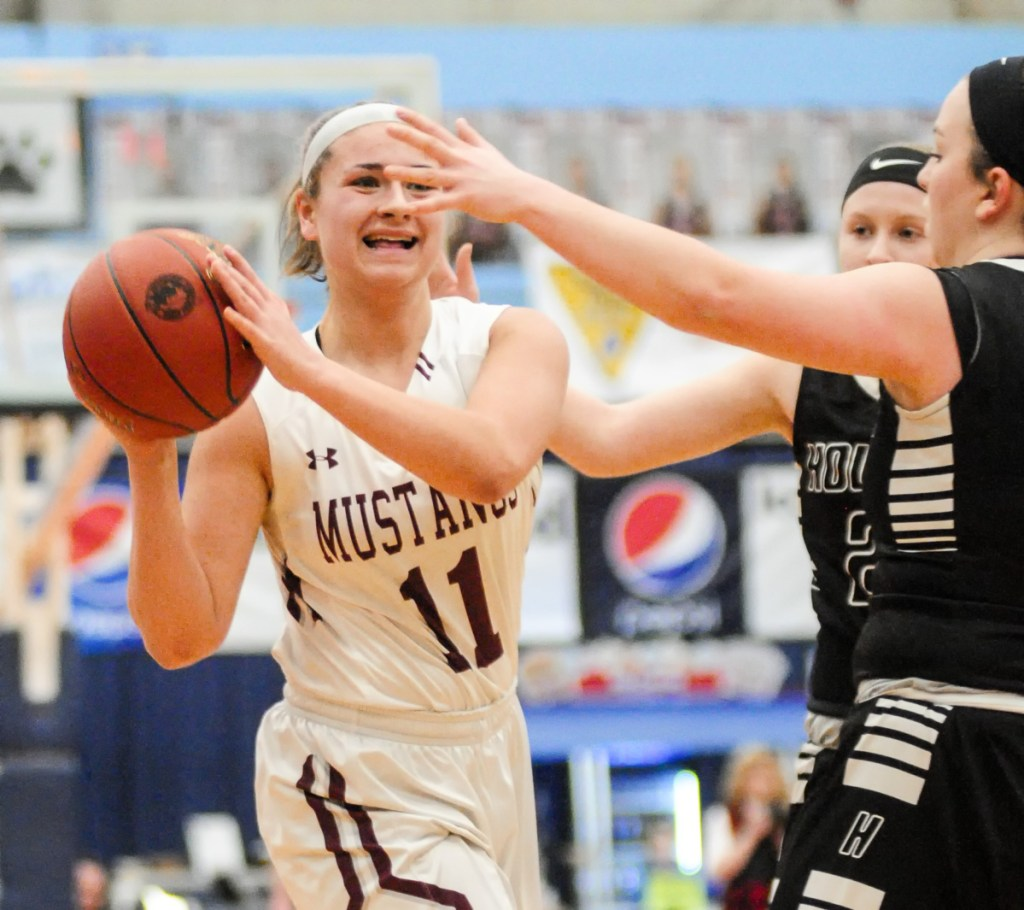 Staff photo by Joe Phelan   Monmouth's Hannah Anderson (11) looks for a teammate to pass to against Houlton in the Class C state championship game Saturday at the Augusta Civic Center.