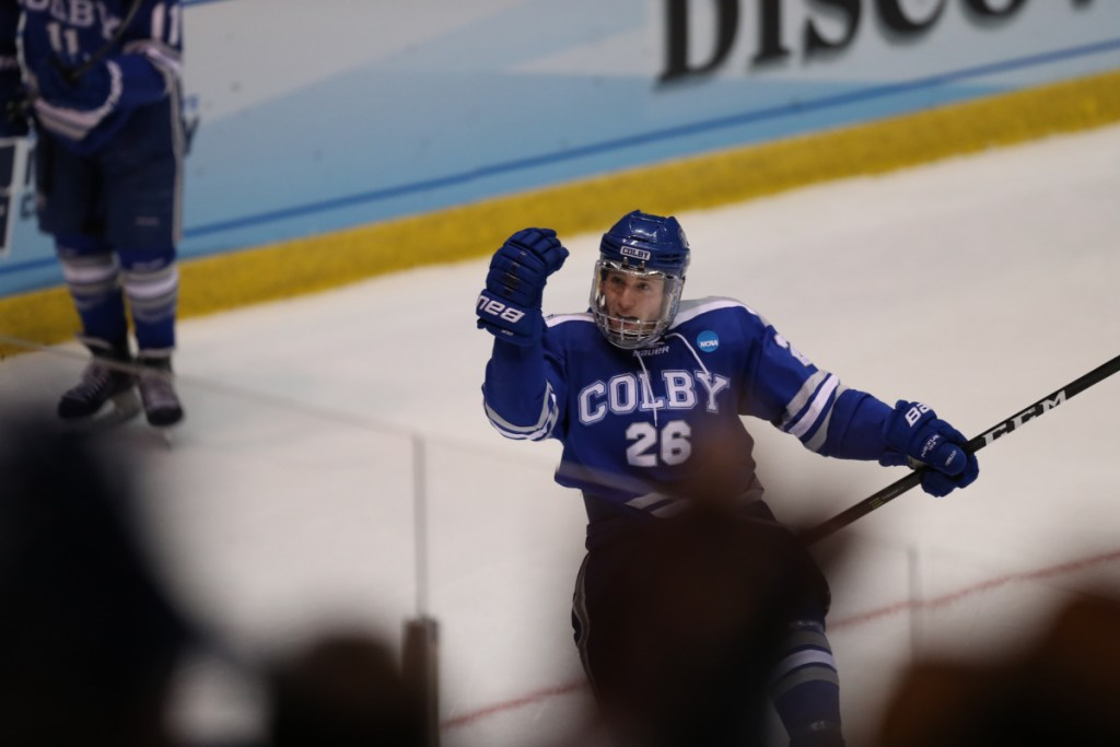 Contributed photo/Colby athletics   Colby J.P. Schuhlen celebrates after the Mules scored their first goal against St. Norbert College during a Division III Frozen Four game Friday in Lake Placid.