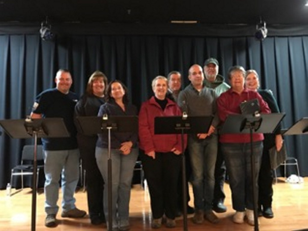 """Cast members of """"The World of Carl Sandburg,"""" from left, are Arthur Bourget, Kathy Kauffman, Cindy Turcotte, Ginger Smith, Frank Omar, David Moisan, Bill Haley, Christine Heckman, and Connie LaFlamme."""