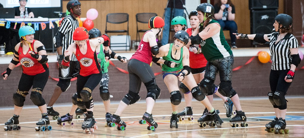 The Inferno's Queen Bootycca aka Erin Lynch, second from left, breaks away from the pack during the first bout of the night against Northwood Knockouts at the Lewiston Armory on Saturday. The Slam-i-versary roller derby double header was sponsored by the Androscoggin Fallen Angels Roller Derby League.