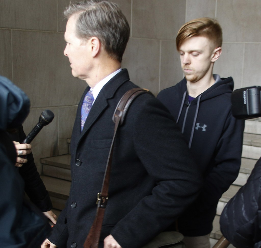 Ethan Couch, right, is released from the Tarrant County Corrections Department jail in Fort Worth, Texas, as his attorney is being interviewed Monday.