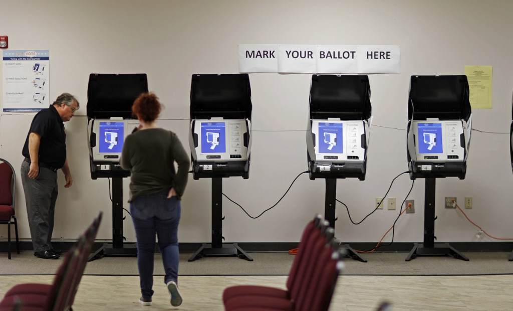 Technicians test voting machines in Conyers, Ga., in 2017. Congress allocated $380 million in March to help states update technology, but many remain at risk months before the midterms.