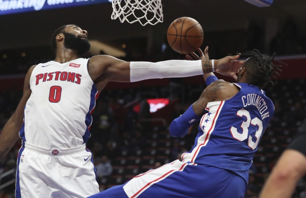 Philadelphia 76ers forward Robert Covington (33) passes as Detroit Pistons center Andre Drummond (0) defends during the second half of an NBA basketball game, Wednesday, April 4, 2018, in Detroit. (AP Photo/Carlos Osorio)