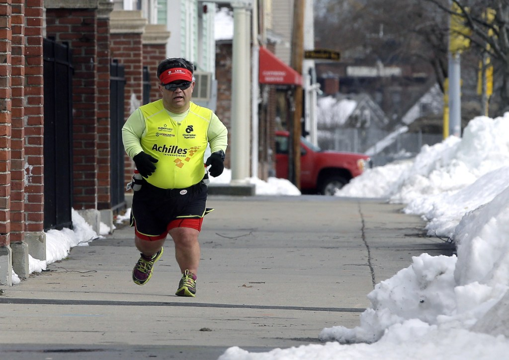 Runner John Young makes his way along a training route in Salem, Mass. in March.